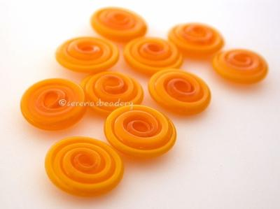 Pumpkin Wavy Disk Spacer 10 wavy disks in pumpkin orange2 sizes available: 11-12 mm with 1.5 mm hole or 13-14 mm with 2.5 mm holeprice is per 10 disks 11-12 mm 1.5 mm hole,12-13 mm 2.5 mm hole