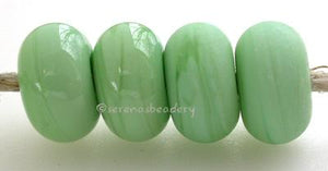 Mint Green Color Notes: a pale mint green shade 5x10 mm Available shapes and sizes:Round Bead Shapes: Available to order 8 to 15 mm with hole sizes ranging from 1.5 to 5 mm. See drop down menu for the exact options. Shown here in 8, 9 and 10 mm with both a 2.5 mm and 1.5 mm hole. 4 and 5 mm holes will fit European Charm style jewelry.Also available in a wavy disk or bead cap:. Pressed bead shapes:Lentil - 12x13 mm in size with a 1.5mm hole.: Pillow 13 mm square with a 1.5 mm hole.: Tab: Default Title