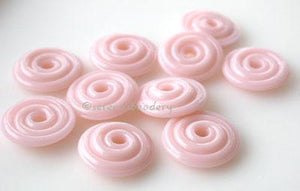 Desert Pink Wavy Disk Spacer 10 wavy disks in desert pink2 sizes available: 11-12 mm with 1.5 mm hole or 13-14 mm with 2.5 mm holeprice is per 10 disks 11-12 mm 1.5 mm hole,12-13 mm 2.5 mm hole