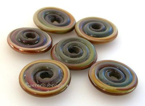 Raku Wavy Disk Spacer 6 wavy disks in raku2 sizes available: 11-12 mm with 1.5 mm hole or 13-14 mm with 2.5 mm holeprice is per 10 disks 11-12 mm 1.5 mm hole,12-13 mm 2.5 mm hole