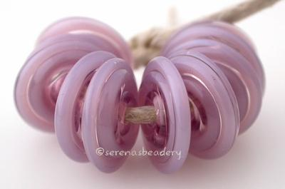 Pearl Violet Wavy Disk Spacer 10 wavy disks in pearl violet2 sizes available: 11-12 mm with 1.5 mm hole or 13-14 mm with 2.5 mm holeprice is per 10 disks 11-12 mm 1.5 mm hole,12-13 mm 2.5 mm hole