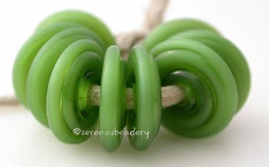 Mystic Green Tumbled Wavy Disk Spacer 10 tumbled wavy disks in mystic green2 sizes available: 11-12 mm with 1.5 mm hole or 13-14 mm with 2.5 mm holeprice is per 10 disks 11-12 mm 1.5 mm hole,12-13 mm 2.5 mm hole