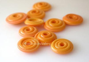 Squash Orange Wavy Disk Spacer 10 wavy disks in squash orange2 sizes available: 11-12 mm with 1.5 mm hole or 13-14 mm with 2.5 mm holeprice is per 10 disks 11-12 mm 1.5 mm hole,12-13 mm 2.5 mm hole