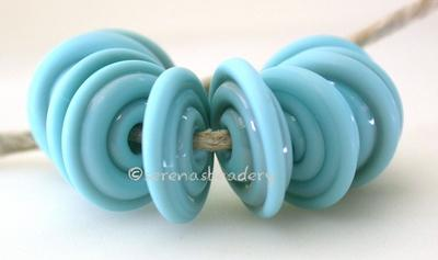 Light Turquoise Tumbled Wavy Disk Spacer 10 tumbled wavy disks in light turquoise2 sizes available: 11-12 mm with 1.5 mm hole or 13-14 mm with 2.5 mm holeprice is per 10 disks 11-12 mm 1.5 mm hole,12-13 mm 2.5 mm hole