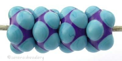 Cobalt Turquoise Bumps beads with a cobalt base and turquoise bumps 7x13 mm price is per bead Glossy,Matte