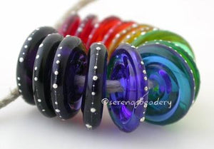 Rainbow Silver Wrapped Wavy Disc Set A set of rainbow wavy disk pairs wrapped in fine silver. The colors range from red, orange, yellow, green, blue, indigo, and violet. 3x14mm price is per set of 14 beads Glossy,Matte