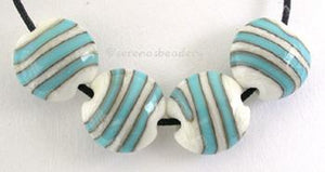 Ivory and Turquoise Lentil Stripes ivory lentils with turquoise spiral stripesshown as 11x12 mm, also availble in 14x14 mmprice is per bead Glossy,11x12mm,Glossy,14x14mm,Matte,11x12mm,Matte,14x14mm