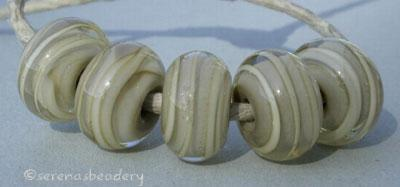 Sage and Ivory Spiral sage heart beads with an ivory ribbon spiral stripe6x12 mmprice is per bead Default Title