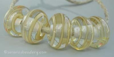 Ivory Spiral Stripe an ivory ribbon spiral stripe with a clear heart6x12 mmprice is per bead Default Title