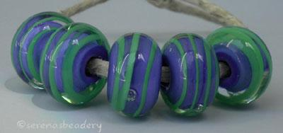 Cobalt Nile Spirals a light cobalt base cased with a nile green ribbon spiral6x12 mmprice is per bead Default Title