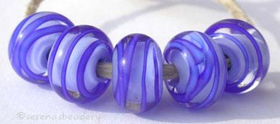 Periwinkle Cobalt Sprials a periwinkle base cased with a cobalt ribbon spiral6x12 mmprice is per bead Default Title