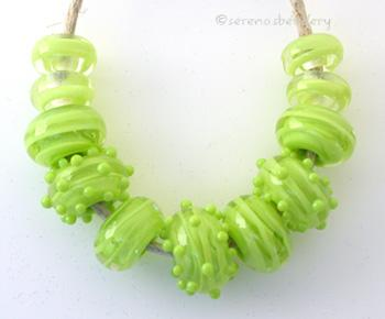 Double Pea Green Ribbon Spirals a set of pea green cased with pea green ribbon spirals, plus some dots!6x12 mm Default Title