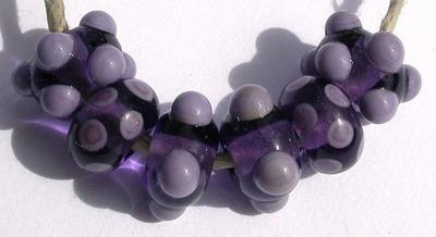 All Purple Transparent light purple beads with raised violet dots and spots. A set of 6 beads about 6x11 mm. Price is per set of beads Glossy,Matte