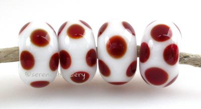 White Deep Red Dice Dots A white base with deep red dice dots. 5x11 mm price is per bead Glossy,No,Glossy,Yes,Matte,No,Matte,Yes