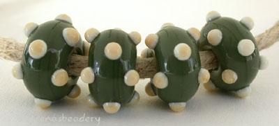 Olive Ivory Dots Olive beads with ivory dots. 6x11 mm price is per bead Glossy,Matte