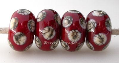 Opaque Red Silvered Ivory Dice An opaque red base with silvered ivory dice dots. 5x11 mm price is per bead Glossy,Matte