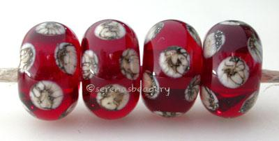 Transparent Red Silvered Ivory Dice A transparent red base with silvered ivory dice dots. 5x11 mm price is per bead Glossy,Matte