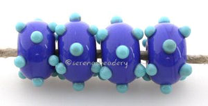 Cobalt Turquoise Raised Dice Dots A cobalt base with raised turquoise dice dots. 5x11 mm price is per bead Glossy,No,Glossy,Yes,Matte,No,Matte,Yes