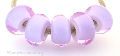 Dark Lavender White Heart dark lavender with a white heart6x12 mmprice is per bead Glossy,Matte
