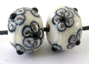 Silvered Ivory and Black Flowers a pair of ivory beads with black and silvered ivory flowers 6x12 mm 1.5 mm hole   Glossy,Matte