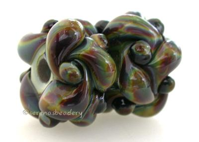 Strictly Raku Wovens a pair of wovens in raku These woven beads are a very intricate and unique design with lots of texture. These are all one color for plenty of sparkle. 7x13 mm price is per pair Glossy,Matte