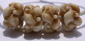 Ivory Tea 4 ivory tea stained woven beadsThese woven beads are a very intricate and unique design with lots of texture. These have been stained in tea. While, the stains are permanent, I do recommend that you not get them wet. Some of the color could be washed off.7x13 mm Default Title