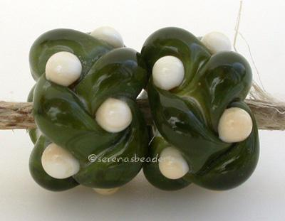 Olive and Ivory Woven a pair of olive and ivory woven beads the woven beads are a very intricate and unique design with lots of texture 7x13 mm also available in reverse Glossy,No,Glossy,Yes,Matte,No,Matte,Yes