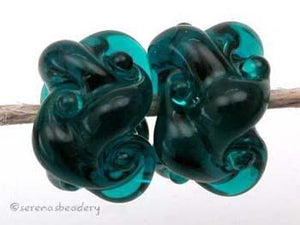 Dark Teal Woven a pair of dark teal woven beadsthe woven beads are a very intricate and unique design with lots of texture 7x13 mm Glossy,Matte