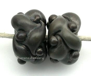 Graphite Woven a pair of graphite colored woven beadsthe woven beads are a very intricate and unique design with lots of texture 7x13 mm Glossy,Matte