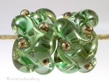 Pale Emerald Silvered Ivory Wovens a pair of wovens with silvered ivory as a base and matching dots - shown here in pale emerald greenThese woven beads are a very intricate and unique design with lots of texture. These are all one color for plenty of sparkle.7x13 mm Glossy,Matte