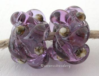 Lavender Silvered Ivory Wovens a pair of wovens with silvered ivory as a base and matching dots - shown here in dark lavenderThese woven beads are a very intricate and unique design with lots of texture. These are all one color for plenty of sparkle.7x13 mm Glossy,Matte