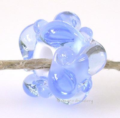 Transparent White Heart European Charm Woven Bead One of my woven white heart beads with a hole large enough to fit a european charm bracelet. Shown here in light blue.10x17 mm4 mm hole Glossy,1004 Clear,Glossy,1014 Medium Amber,Glossy,1022 Medium Grass Green,Glossy,1026 Light Teal,Glossy,1030 Dark Emerald,Glossy,1036 Dark Aqua,Glossy,1042 Medium Amethyst,Glossy,1052 Light Blue,Glossy,1058 Ink Blue,Matte,1004 Clear,Matte,1014 Medium Amber,Matte,1022 Medium Grass Green,Matte,1026 Light Teal,Matte,1030 Dark E