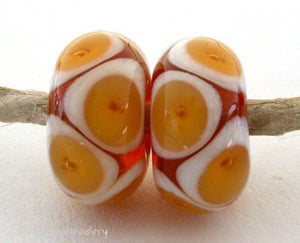 Amber Ivory Bubbles transparent amber and ivory offset bubbles. 7x12 mm 2.5 mm hole All of my lampwork glass beads are individually handmade using Effetre, Vetrofond, or Lauscha, Reichenbach, Double Helix, and Bullseye glass rods. They are annealed in a digitally controlled kiln for everlasting strength and durability.   Default Title