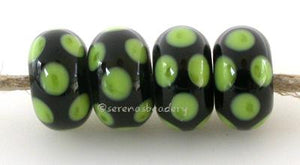 Black Pea Green Dice Dots A black base with pea green dice dots. 5x11 mm price is per bead Glossy,Matte