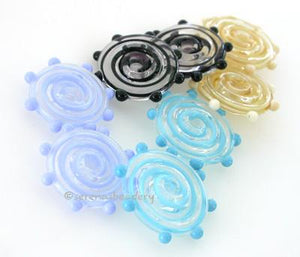 Ribbon Wavy Disks with Dots Ribbon disks with matching dots - shown here in dark turquoise, periwinkle, black, and ivory.3x17-18 mmprice is per 6 disks Default Title