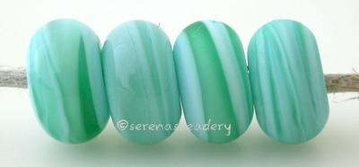 Caribbean Sea Color Notes: streaky aqua and sky blue 5x10 mm Available shapes and sizes:Round Bead Shapes: Available to order 8 to 15 mm with hole sizes ranging from 1.5 to 5 mm. See drop down menu for the exact options. Shown here in 8, 9 and 10 mm with both a 2.5 mm and 1.5 mm hole. 4 and 5 mm holes will fit European Charm style jewelry.Also available in a wavy disk or bead cap:. Pressed bead shapes:Lentil - 12x13 mm in size with a 1.5mm hole.: Pillow 13 mm square with a 1.5 mm hole.: Tab: Default Title