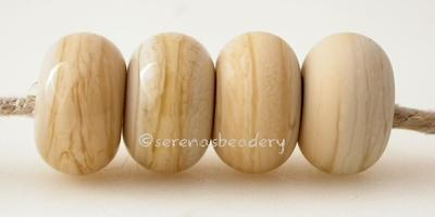Sandstone Color Notes: streaky ivory 5x10 mm Available shapes and sizes:Round Bead Shapes: Available to order 8 to 15 mm with hole sizes ranging from 1.5 to 5 mm. See drop down menu for the exact options. Shown here in 8, 9 and 10 mm with both a 2.5 mm and 1.5 mm hole. 4 and 5 mm holes will fit European Charm style jewelry.Also available in a wavy disk or bead cap:. Pressed bead shapes:Lentil - 12x13 mm in size with a 1.5mm hole.: Pillow 13 mm square with a 1.5 mm hole.: Tab: Default Title