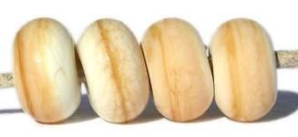 Dark Ivory Color Notes: A mottled color with streaks of brown 5x10 mm Available shapes and sizes:Round Bead Shapes: Available to order 8 to 15 mm with hole sizes ranging from 1.5 to 5 mm. See drop down menu for the exact options. Shown here in 8, 9 and 10 mm with both a 2.5 mm and 1.5 mm hole. 4 and 5 mm holes will fit European Charm style jewelry.Also available in a wavy disk or bead cap:. Pressed bead shapes:Lentil - 12x13 mm in size with a 1.5mm hole.: Pillow 13 mm square with a 1.5 mm hole.: Tab: Defaul