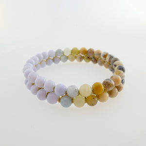Gemstone bracelet by Pellara, inspired by nature. Infinite fields, made of agate, quartz, aquamarine and opal. Aries, Gemini, Scorpio, Leo & Capricorn zodiacs. 6mm stones