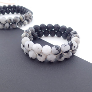 Gemstone bracelet by Pellara, Yin & Yang, made of Lava rock, Map Jasper, Black Silk Stone, Rutilated Quartz & Howlite.