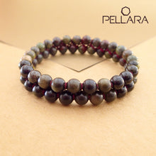 Load image into Gallery viewer, Chakra gemstone bracelet for The Base (Root) Chakra designed by Pellara. Made in Canada. Contains Black Tourmaline, Black Obsidian and Dragon Blood Stone crystals.