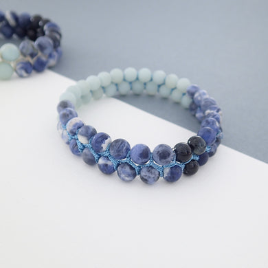 Gemstone bracelet by Pellara, inspired by Blue Jay, made of Amazonite, Sodalite, Blue Tiger. Aries, Scorpio, Gemini, Pisces & Leo zodiacs. 6, 8 & 10mm.