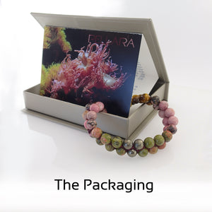 Gift package of Coral Reef Gemstone bracelet by Pellara, shows colour combination of corals, made of Tiger Eye, Unakite, Rhodonite and Pyrite