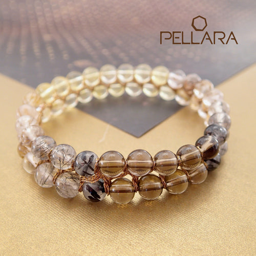 Chakra gemstone bracelet for the Crown Chakra, designed by Pellara. Made in Canada. Contains Citrine, Smoky Quartz and Golden Rutilated Quartz crystals