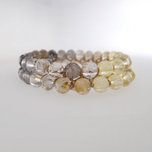 Chakra gemstone bracelet for the Crown Chakra, designed by Pellara. Made in Canada. Contains Citrine, Smoky Quartz and Golden Rutilated Quartz crystals.