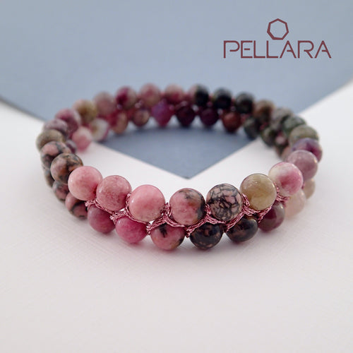 Chakra gemstone bracelet for The Heart Chakra, designed by Pellara. Made in Canada. Contains Rhodonite and Tourmaline crystals.