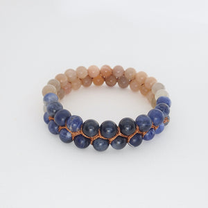 Gemstone bracelet, Twilight by Pellara. Made of Sunstone, Moonstone, Blue Tiger Eye and Sodalite. The Crown, Throat, Sacral and Navel chakras.