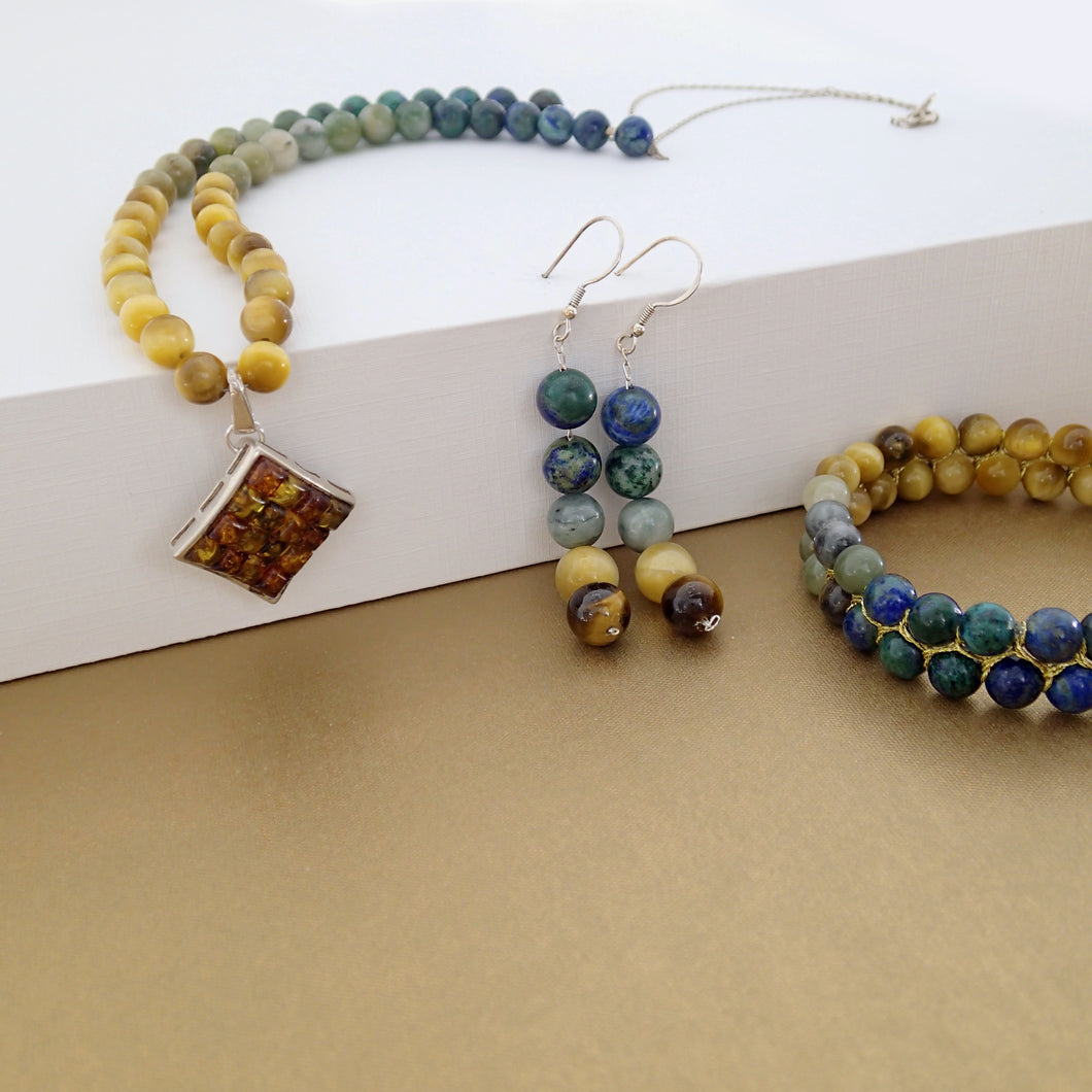 Gemstone necklace, earrings and bracelet jewellery set by Pellara, made of azurite malachite, Tiger's eye, amber & Indian Jade