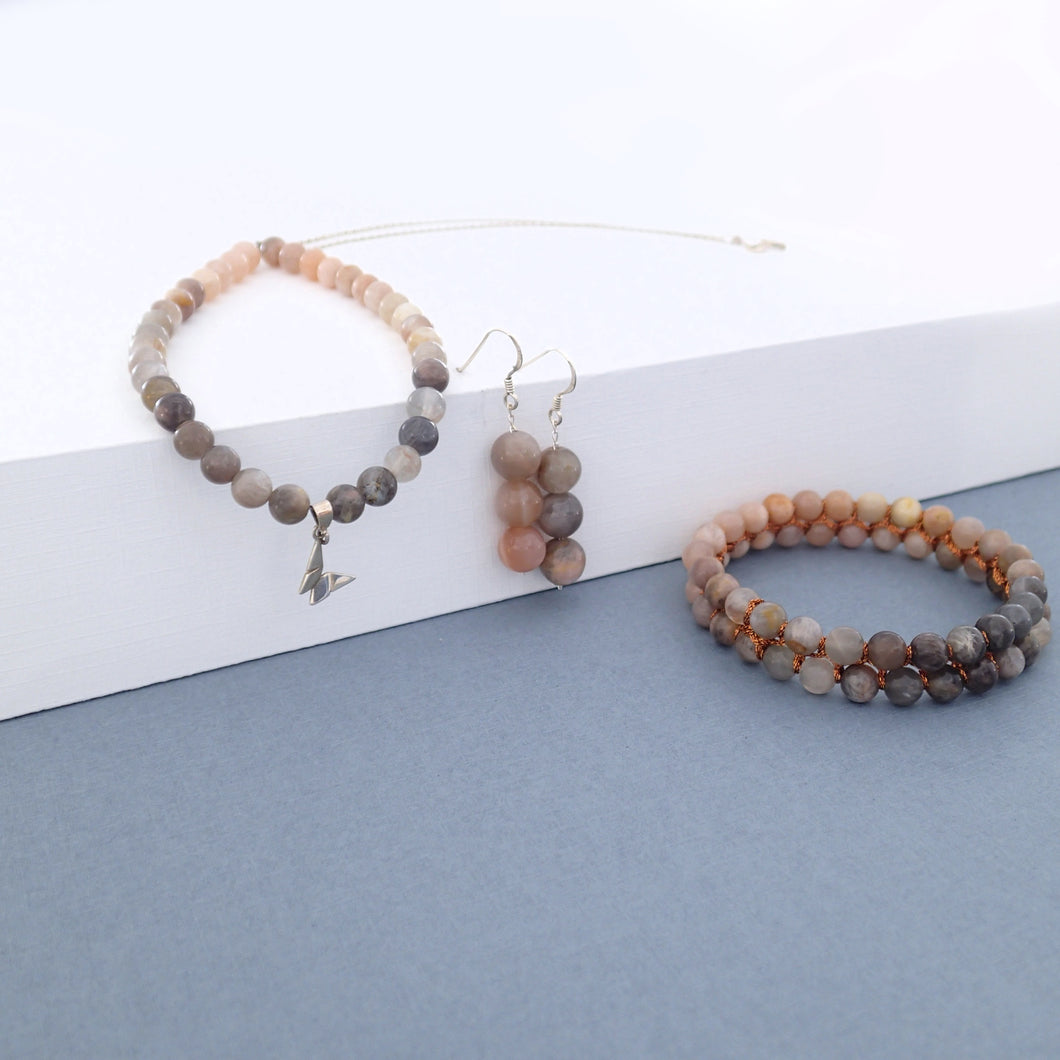 Gemstone jewellery set, Dawn, by Pellara. Made of Sunstone and Moonstone. Birthstone gift for Cancer zodiac. The Crown and sacral chakra.