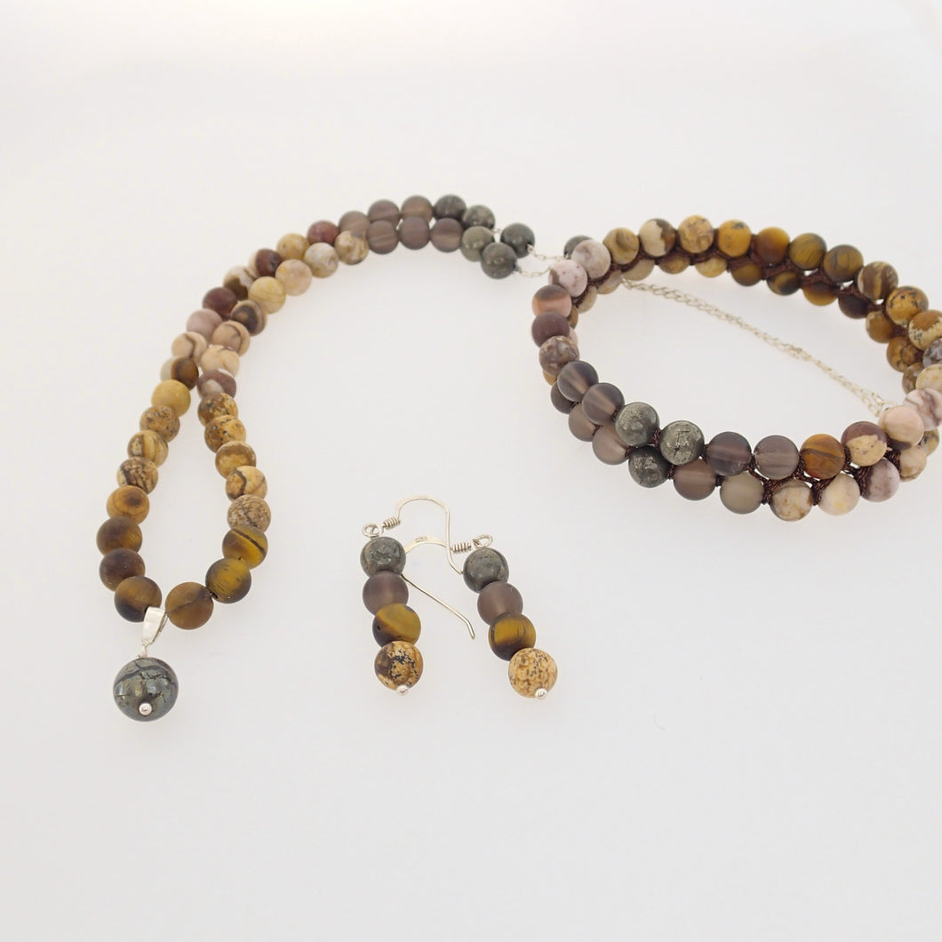 Gemstone jewellery set by Pellara, Oasis, made of Pyrite, Smoky Quartz, Jasper & Tiger eye. Leo, Virgo, Scorpio, Sagittarius, Capricorn & Gemini zodiacs. Aromatherapy